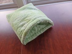 Underneath gently waving ferns fronds, spy this cute this cuddle sack -- best for small pets who like to burrow, like mice, hedgehogs and like-sized small pets   PLEASE NOTE: We offer 3 sizes--Small sized sack is only for baby pets and the smallest of small pets  ^^^^^^^❤ ❤ ❤^^^^^❤ ❤ ❤^^^^^^^  Materials:  flannel exterior softest fleece inside*  polyester batting   *shown w. minky (nubby) interior but will have solid light green fleece inside  Snuggle Sack has built- in boning to provide…