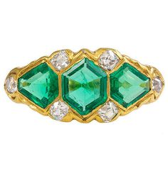 Victorian Emerald Diamond Gold Ring,     An antique three-stone emerald ring with diamond accents, in 18k gold. United Kingdom, Circa 1890.