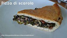 La pizza di scarola è una torta salata tipica del napoletano che si prepara soprattutto per il 24 e 31 dicembre,quando si aspetta il cenone serale e a pranzo si mangia questa squisita torta ripiena di scarola,tipicamente invernale,insaporita con olive nere di Gaeta,capperi,acciughe,aglio,pinoli e uvetta. http://blog.giallozafferano.it/lacucinadimilena/pizza-di-scarola/