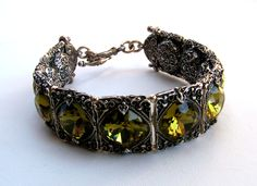 Richly ornamented silver bracelet with green Swarovski crystals