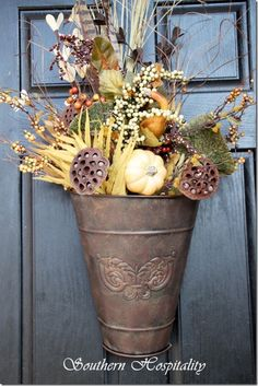 Such a pleasing door arrangement with a few faux floral picks from your local craft store. Maybe Change the colors up for a spring arrangement! Diy Fall Wreath, Autumn Wreaths, Thanksgiving Decorations, Seasonal Decor, Fall Crafts, Holiday Crafts, Front Door Decor, Fall Harvest, Fall Halloween