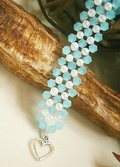 SALE STARTS TODAY..10% OFF EVERYTHING Pale Blue Bicone Crystal & White Glass Pearl Bracelet £7.00