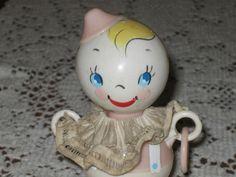 crib doll, baby clown