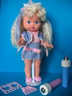 I don't even know if this was a popular 80's toy, but I had one and I totally forgot about it until researching for this hub. I remember filling those containers with icy water water and they changed her clothes and hair blue and pink.