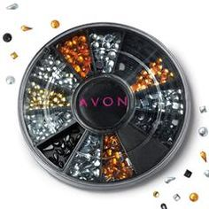 """Avon Nail Gems.  Easily add a little sparkle this holiday season.  Simply add jewels onto nails over wet polish then cover with top coat.  Includes 12 different designs in graduated sizes.  Approx. over 450 individual gems.  Plastic Case, 2 1/8"""" diam.  www.AvonByLynne.com"""