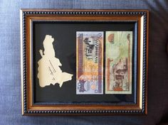 An alternative to maps: display your travels with their currency and a cut-out of the country.  I traced the outline of the DR, painted it an off-white cream and cut it out.  The country name in cursive identifies the cream-colored blob as a country, not a blob.