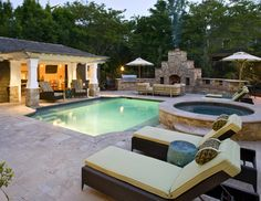 Poolandspa.com Modern Swimming Pool with Custom concrete hot tub.