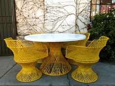 Retro Mid Century Outdoor Patio Set.  The chairs are a bit much, but I LOVE the table.
