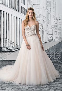Brides: Justin Alexander. See More Details from Justin AlexanderGolden beaded details heavily adorn the strapless sweetheart bodice. The beading continues down the train of the full tulle skirt of this ball gown with a natural waist and cathedral length train.