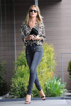 Rosie Huntington Whiteley street style with animal print shirt, skinny jeans and strap sandals.