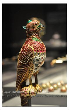 From Qatar Islamic Museum, Jeweled Falcon India c. 1640 Gold with enamel and india rubies, emeralds, diamonds, sapphires and onyx. Made in the Imperial Mughal workshop and was part of the private jewels of Shah Jahan Height: Width: Diameter: Mughal Jewelry, Indian Jewelry, Antique Jewelry, Vintage Jewelry, Royal Jewels, Crown Jewels, Bird Jewelry, Jewelry Design, Designer Jewellery