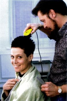 Sigourney Weaver getting her head shaved on the first day of shooting Alien 3 circa 1991.