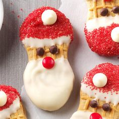 Santa Claus Cookies Recipe -Store-bought peanut butter sandwich cookies become jolly Santas with white chocolate, colored sugar, mini chips and red-hot candies. —Mary Kaufenberg, Shakopee, Minnesota
