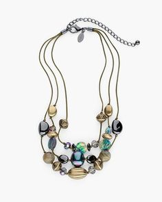 Dramatic beading dances on multi-tiered strands, in a dazzling necklace of iridescent stones and etched baubles.   Acrylic, rayon, metal, glass and other.  Imported.