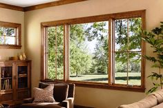 Window materials like wood, wood-clad, vinyl or fiberglass are all good choices for replacement windows. Pvc Windows, Wooden Windows, House Windows, Windows And Doors, Balcony Grill, Flat Roof House, Vinyl Frames, Window Replacement, Interior Trim