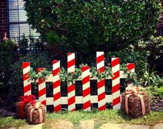 Candy Cane Picket Fence This fence will look great simply holding your favorite Christmas stockings, on the porch or even serving as a backdrop for your family photos! You have the option to receive t Outside Christmas Decorations, Christmas Wood Crafts, Pallet Christmas, Decorating With Christmas Lights, Christmas Porch, Christmas Projects, Simple Christmas, Christmas Stockings, Outdoor Candy Cane Decorations