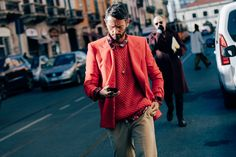 The best men's street style from Milan Fashion Week, featuring trendy sporty looks and tailored suits