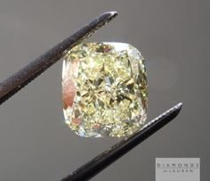 3.15ct cushion cut yellow diamond