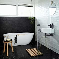 A monochrome bathroom is not hard to attain. It may give the room a luxury bathroom texture. Black and white bathroom does not have to be traditional. A black and white bathroom is a contemporary and classic style option, however… Continue Reading → Bathroom Tile Designs, Modern Bathroom Design, Bathroom Interior Design, Bathtub Designs, Bath Design, White Subway Tile Bathroom, Black White Bathrooms, Bathroom Taps, Subway Tiles