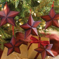 "5-Star Ornamentals (set of 5)     Handcrafted, distressed red metal stars go beyond Christmas tree ornaments! Lace with ribbon to decorate a mantel or banister, use as gift tags or secure with raffia as a festive napkin ring. Coordinates with Large Liberty Pocket Star. Triangle hook for convenient hanging. 5""h set/5.  $8.99"