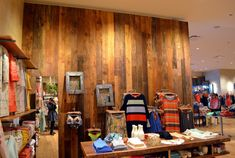 The interior side of American Prairie (barn wood) reveals rich brown tones adding warmth to a retail space in Chicago.