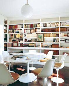 saarinen table & floor to ceiling shelves