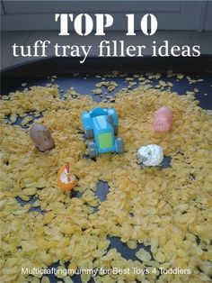 Top 10 Tuff Tray Filler Ideas, part of Less Toys. More Play series. Including ideas using cereal, shaving foam, water, dinosaurs and teddy bears.