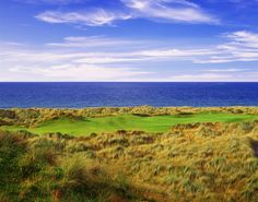 Enniscrone Golf Club. This Ireland golf course winds in and out of the dunes along the Killala Bay, near the picturesque seaside town of Enniscrone.