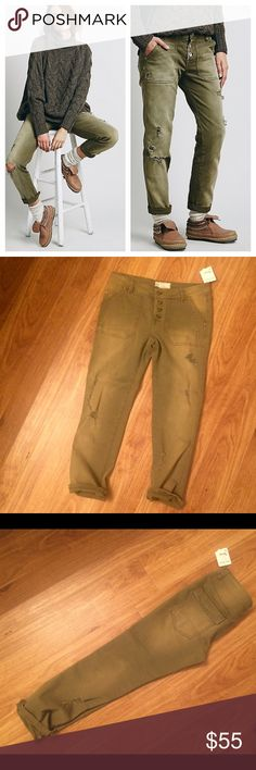 """Free People Distressed Jeans Free People Mountaineer Relaxed Jeans in """"Fatigue"""" which in person is like an olive/army green. It doesn't say """"boyfriend"""" but it fits """"relaxed""""/boyfriend style. Wear them with sneakers or wedges or booties. It's has a little mark at the bottom left leg from storage but nothing that can't be washed off, shown in last photo. NWT. Price dropped from $60! Free People Jeans Boyfriend"""