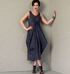 V1410 Very loose-fitting, pullover dress has very narrow hem finish on neckline and armholes, front and back pleats, inside button/buttonholes forming drape and three adjustable lengths, French seams, and narrow hem. Purchased cord stopper and elastic cord form front drape. #voguepatterns