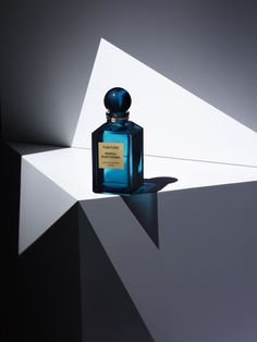 Background gives it interest whilst not taking the attention away from the bright blue bottle. The shapes gives the impression that the smell is sharp and interesting