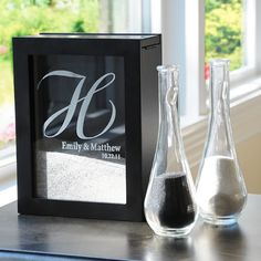 Personalized Unity Sand Ceremony Shadow Box Set.  I like it because it is Monogrammed and the sand is sealed within