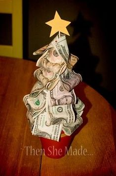 Instead of giving a gift card or money in a Chirstmas card, give a money Christmas tree! Cute and Easy idea!