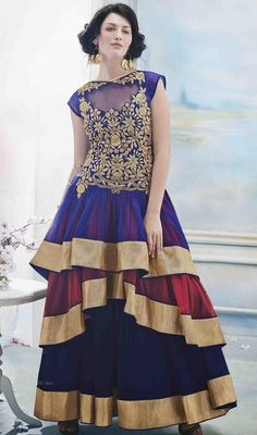 Charm and enchain the people in awe enfolding yourself in this blue and maroon net layered gown. The bead, resham and stones work on attire personifies the total appearance. #AmazingThreeFrillNetGown