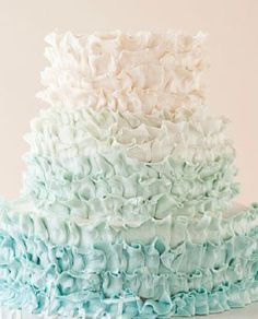 Teal, saturated hues give way to pale shades of sea foam green to white on this edible ombre.