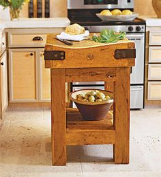 Butcher block island...something sort of like this i think would be cool in our new kitchen :)