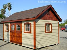 10'x16' Garden Shed with lap siding, cedar impression gable, carriage house doors, gable vents, and 4 arched wood windows http://www.backyardunlimited.com/sheds/garden-sheds