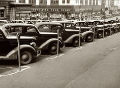 "November 1938. Omaha, Nebraska. ""Cars parked diagonally along a row of parking meters."" View full size. Photograph by John Vachon for the FSA. - Shorpy Historical Photo Archive :: Omaha: 1938"