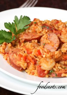 Jambalaya with Shrimp and Andouille Sausage Yield: 4 servings (serving size: 1 1/2 cups = 426 calories).