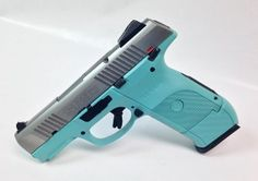 This is a Ruger SR9 Compact with Stainless Steel Slide and Tiffany Blue Frame for $499.99! Pick up yours today! - www.tzarmory.com
