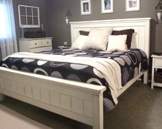Beautifully done Farmhouse bed.  Love the wall coloring!