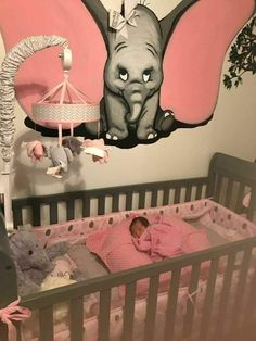 Baby girl elephant decor I like the art. Could use more grey with pink accents in the room