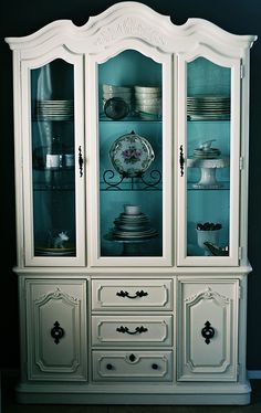 painting inside of cabinet. Nice touch. Bring colour into a whitespace - easy to change,.