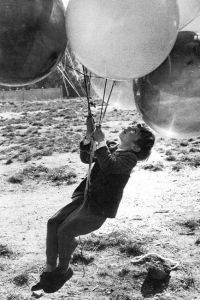 Ah, the joy of balloons for children!  Simple pleasures!  As a child I often dreamed of floating away with lots of helium filled balloons!