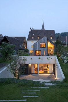 Kirchplatz Office + Residence by Oppenheim Architecture + DesignFlorida-based firmOppenheim Architecture + Designand Swiss studioHuesler Architekten have created offices for themselves in an eighteenth centur... Architecture Check more at http://rusticnordic.com/kirchplatz-office-residence-by-oppenheim-architecture-design/