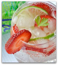 Strawberry Lime Spritzer  One can of sparkling lime La Croix water [or lemon-lime soda]   1-2 shots of strawberry vodka  as many slices of fresh strawberry and lime as you can fit in the glass!
