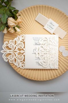This gentle invitation has an off white laser cut pocket which appears to be so very intricate and delicate that you might be fearful of your guests destroying it in their hands. Have no fear! All of our laser cut products at Elegant Wedding Invites are created from card stock that will stand up to a rigorous shipping and normal use. This particular invite comes with a matching mirror bellyband.