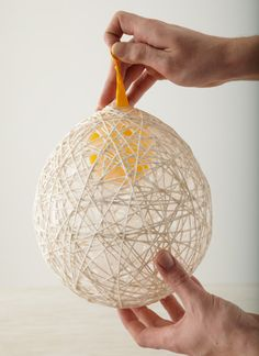 StringBall Used to do this as a kid - just soak yarn or string in glue, and drape around a balloon. When the glue is dry, pop the balloon and pull it out
