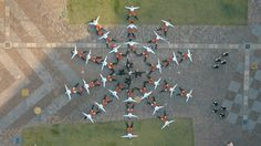 An Elaborately Choreographed Music Video for the Song 'I Won't Let You Down' by OK Go That Uses Robots and Umbrellas