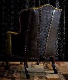 Brown leather studded arm chair with corset style back.